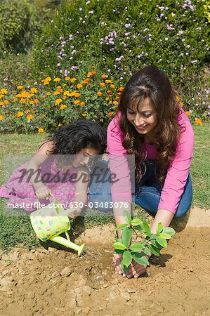 Woman planting with her daughter Stock Photo - Premium Royalty-Free, Image code: 630-03483076