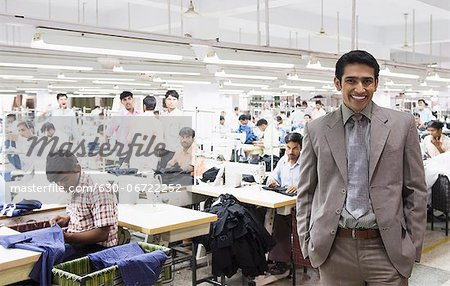 Portrait of a businessman in a textile factory Stock Photo - Premium Royalty-Free, Image code: 630-06722252