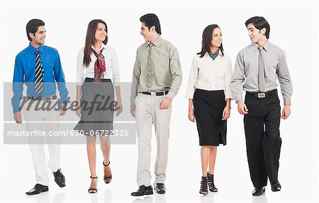 Business executives walking together Stock Photo - Premium Royalty-Free, Image code: 630-06722335