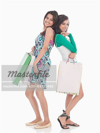 Two friends holding shopping bags Stock Photo - Premium Royalty-Free, Image code: 630-06722460
