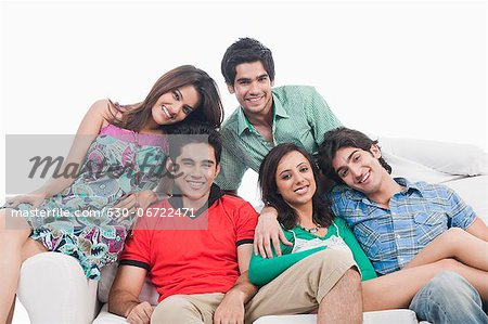 Group of friends on a couch Stock Photo - Premium Royalty-Free, Image code: 630-06722471
