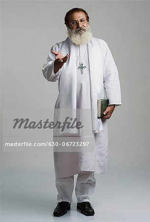 Portrait of a priest gesturing Stock Photo - Premium Royalty-Free, Image code: 630-06723297