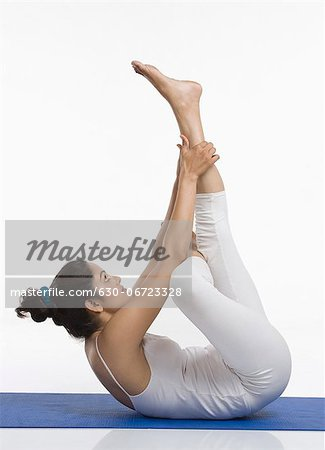 Woman practicing yoga Stock Photo - Premium Royalty-Free, Image code: 630-06723328