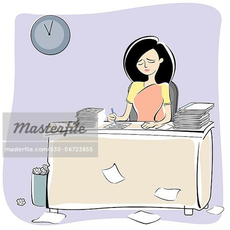 Businesswoman working late in an office Stock Photo - Premium Royalty-Free, Image code: 630-06723855