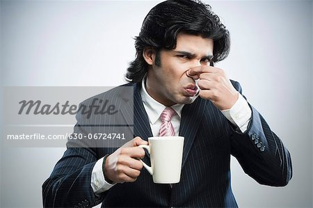 This coffee tastes bad Stock Photo - Premium Royalty-Free, Image code: 630-06724741