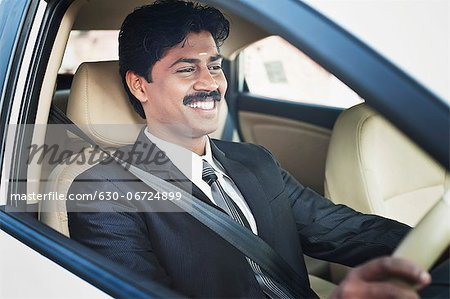 South Indian businessman driving the car Stock Photo - Premium Royalty-Free, Image code: 630-06724899