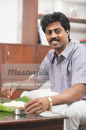 South Indian man having food Stock Photo - Premium Royalty-Free, Image code: 630-06724924
