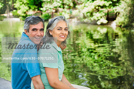 Portrait of a mature couple smiling, Lodi Gardens, New Delhi, India Stock Photo - Premium Royalty-Free, Image code: 630-07071251