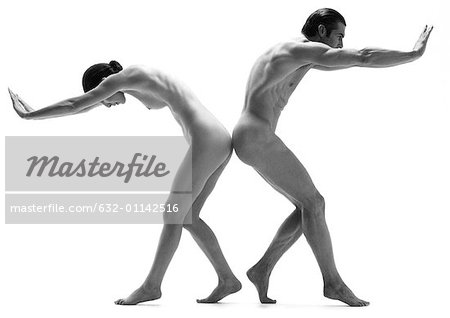 Nude man and woman back to back, leaning forward, pushing with hands, b&w Stock Photo - Premium Royalty-Free, Image code: 632-01142516