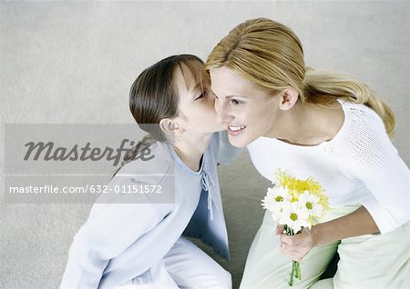 Woman holding bouquet of flowers, girl kissing her cheek Stock Photo - Premium Royalty-Free, Image code: 632-01151572
