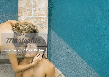 Couple lying by edge of pool Stock Photo - Premium Royalty-Free, Image code: 632-01156300