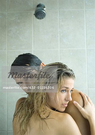 Couple embracing in shower Stock Photo - Premium Royalty-Free, Image code: 632-01156306