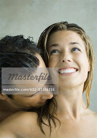 Man kissing woman's neck Stock Photo - Premium Royalty-Free, Image code: 632-01156315