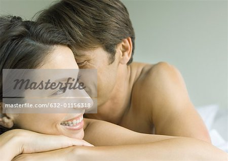 Couple lying in bed Stock Photo - Premium Royalty-Free, Image code: 632-01156318