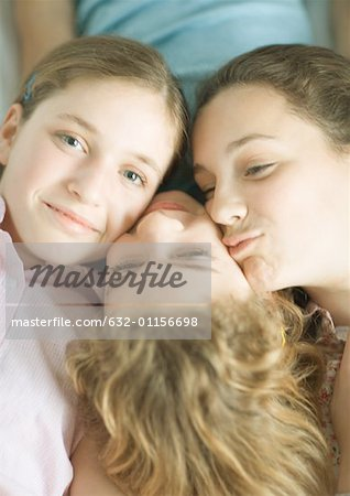 Preteen girls with heads together Stock Photo - Premium Royalty-Free, Image code: 632-01156698