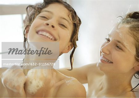 Two preteen girls in shower, laughing Stock Photo - Premium Royalty-Free, Image code: 632-01156728