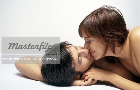 Couple lying together, kissing Stock Photo - Premium Royalty-Free, Image code: 632-02689994