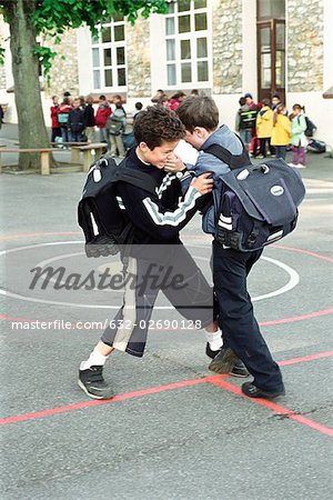 Boys fighting on school playground Stock Photo - Premium Royalty-Free, Image code: 632-02690128