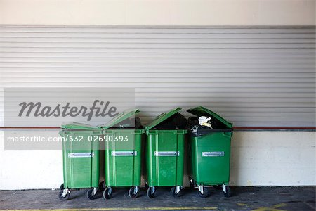 Overflowing garbage cans in a row Stock Photo - Premium Royalty-Free, Image code: 632-02690393