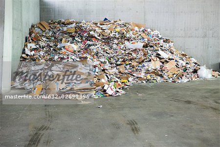 Paper and cardboard piled up in recycling center Stock Photo - Premium Royalty-Free, Image code: 632-02690396