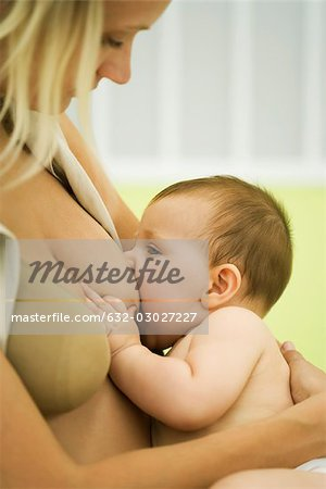 Woman breast feeding baby Stock Photo - Premium Royalty-Free, Image code: 632-03027227