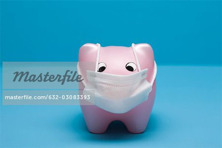 Swine flu concept, toy pig wearing flu mask Stock Photo - Premium Royalty-Free, Image code: 632-03083393