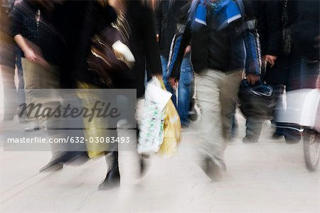Pedestrians walking on sidewalk, blurred Stock Photo - Premium Royalty-Free, Image code: 632-03083493
