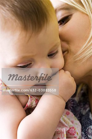 Mother kissing infant's cheek, close-up Stock Photo - Premium Royalty-Free, Image code: 632-03083558