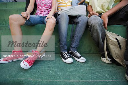 Teenagers sitting together on steps, low section Stock Photo - Premium Royalty-Free, Image code: 632-03424165