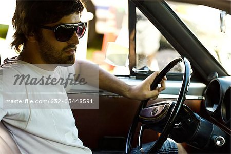 Macho young man driving Stock Photo - Premium Royalty-Free, Image code: 632-03448591