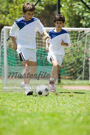 Children playing soccer, cropped Stock Photo - Premium Royalty-Free, Image code: 632-03500666