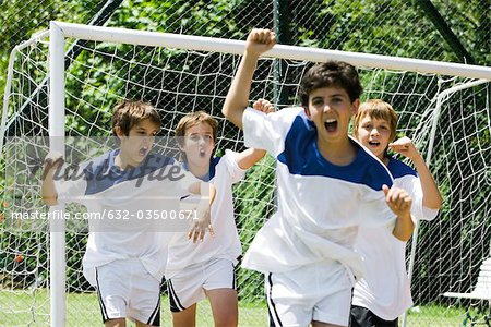 Boys playing soccer Stock Photo - Premium Royalty-Free, Image code: 632-03500671