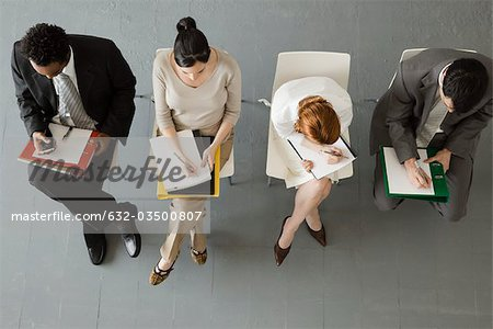 Professionals taking notes during meeting Stock Photo - Premium Royalty-Free, Image code: 632-03500807