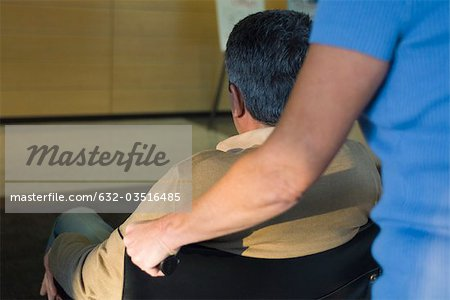 Pushing man in wheelchair Stock Photo - Premium Royalty-Free, Image code: 632-03516485