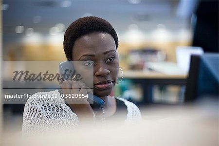 Female office worker talking on phone Stock Photo - Premium Royalty-Free, Image code: 632-03629854