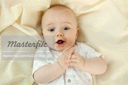 Baby with suprised expression, portrait