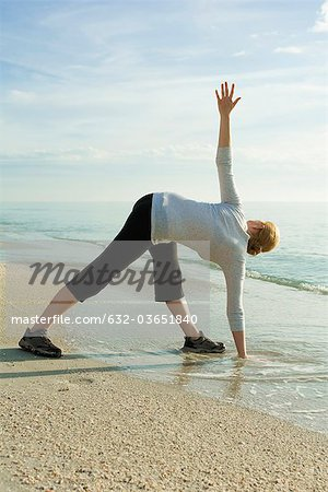 Woman doing yoga at the beach Stock Photo - Premium Royalty-Free, Image code: 632-03651840