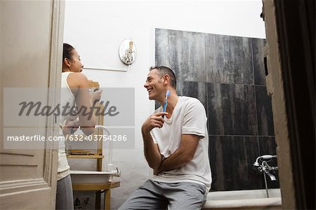 Couple together in bathroom getting ready in morning Stock Photo - Premium Royalty-Free, Image code: 632-03754286