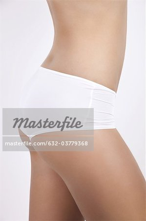 Young woman in underwear, side view of mid section Stock Photo - Premium Royalty-Free, Image code: 632-03779368