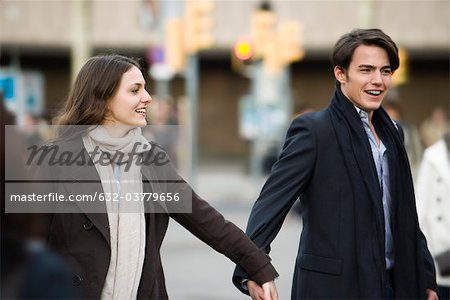 Couple walking hand in hand Stock Photo - Premium Royalty-Free, Image code: 632-03779656