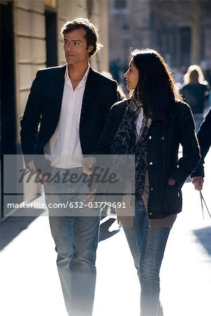 Couple walking together, backlit Stock Photo - Premium Royalty-Free, Image code: 632-03779691