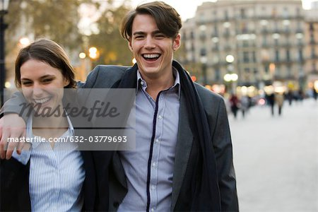 Couple walking on street together Stock Photo - Premium Royalty-Free, Image code: 632-03779693