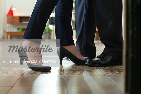 Couple standing face to face, cropped view of feet Stock Photo - Premium Royalty-Free, Image code: 632-03847749