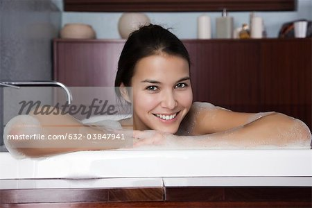 Woman relaxing in bath, portrait Stock Photo - Premium Royalty-Free, Image code: 632-03847941