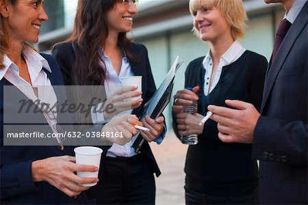 Colleagues taking smoking break outdoors Stock Photo - Premium Royalty-Free, Image code: 632-03848161