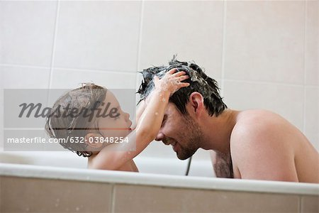 Toddler boy washing father's hair in bath Stock Photo - Premium Royalty-Free, Image code: 632-03848254