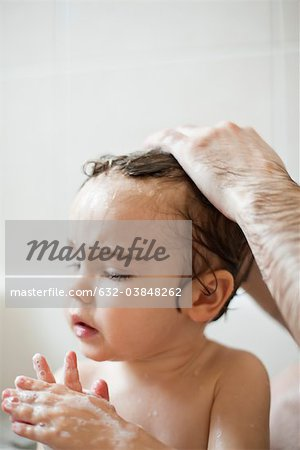 Toddler boy taking a bath Stock Photo - Premium Royalty-Free, Image code: 632-03848262