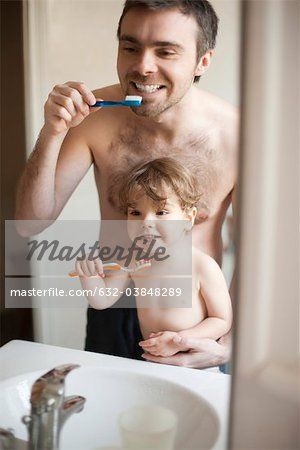 Father and toddler son brushing their teeth together Stock Photo - Premium Royalty-Free, Image code: 632-03848289