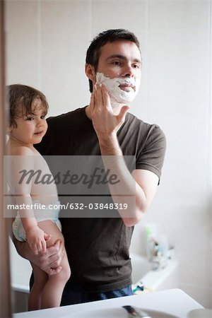 Toddler boy watching his father shave Stock Photo - Premium Royalty-Free, Image code: 632-03848319