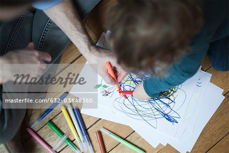 Father and toddler drawing together on paper, high angle view Stock Photo - Premium Royalty-Free, Image code: 632-03848360
